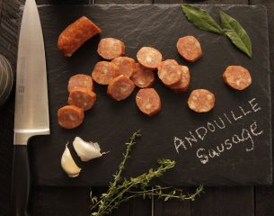 andouille-sausage-on-black-cutting-board