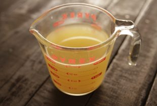 Chicken Stock in Measuring Glass