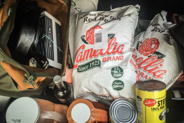 My fully loaded trunk: 75 Pounds of Cornmeal, 5 Pounds of Baking Powder, Steins Cane Syrup, 60 Pounds of Andouille, 75 Pounds of Camellia Red Beans, 1 Gallon of Crystal, 1 huge bottle of Tony Chachere's, My Cast Iron and the old Sound System,